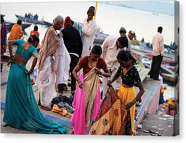 Bath At Ghat Canvas Print by Money Sharma