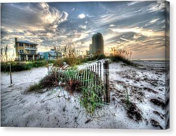 Beach And Buildings Canvas Print by Michael Thomas