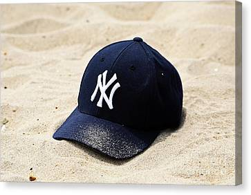 Beach Cap Canvas Print by John Rizzuto