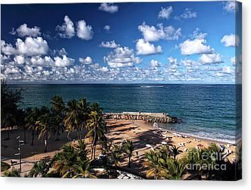 Beach Day At San Juan Canvas Print by John Rizzuto