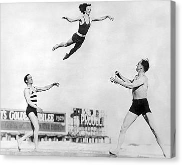 Beach Performers Toss Woman Canvas Print by Underwood Archives