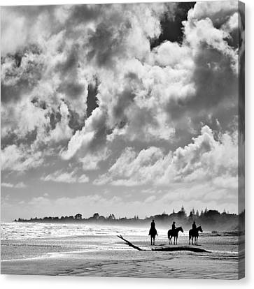 Beach Riders Canvas Print by Dave Bowman