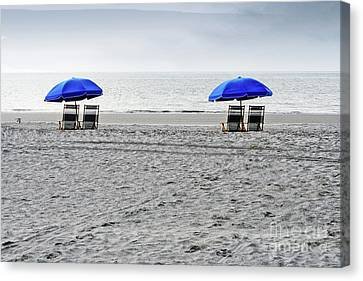 Beach Umbrellas On A Cloudy Day Canvas Print by Thomas Marchessault