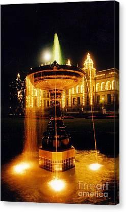 Beautiful Fountain At Night Canvas Print by John Malone