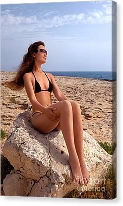 Beautiful Young Woman In Bikini On Rocky Seashore Canvas Print by Oleksiy Maksymenko