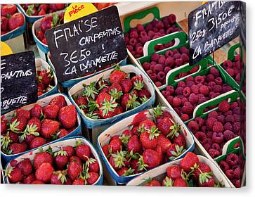 Berries For Sale At The Local Market Canvas Print by Brian Jannsen