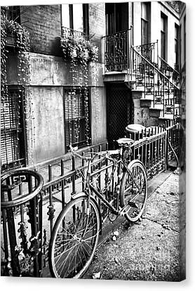 Bicycle In The Village Canvas Print by John Rizzuto
