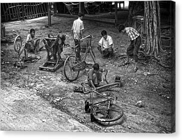 Bicycle Repair In Amarapura Canvas Print by RicardMN Photography