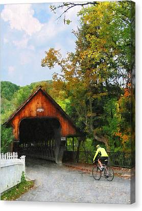 Bicyclist At Middle Bridge Woodstock Vt Canvas Print by Susan Savad