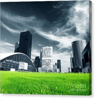 Big City And Green Fresh Meadow Canvas Print by Michal Bednarek