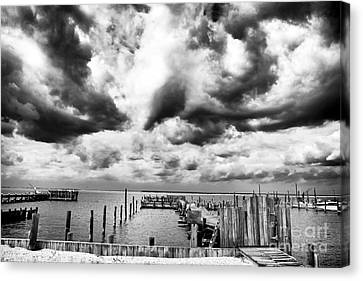 Big Clouds Little Dock Canvas Print by John Rizzuto