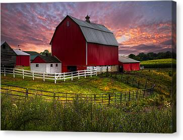 Big Red At Sunset Canvas Print by Debra and Dave Vanderlaan