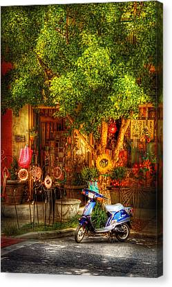 Bike - Scooter - Sitting Amongst Urban Flowers Canvas Print by Mike Savad