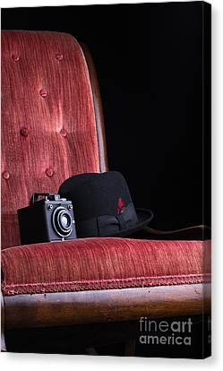 Black Hat Vintage Camera And Antique Red Chair Canvas Print by Edward Fielding