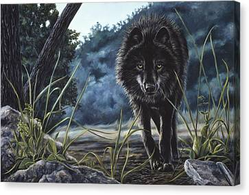Black Wolf Hunting Canvas Print by Lucie Bilodeau