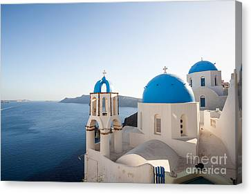 Blue And White Churches In Santorini Greece Canvas Print by Matteo Colombo