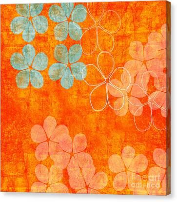 Blue Blossom On Orange Canvas Print by Linda Woods