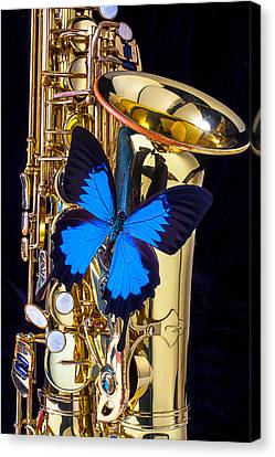 Blue Butterfly On Sax Canvas Print by Garry Gay