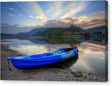 Blue Canoe At Sunset Canvas Print by Debra and Dave Vanderlaan