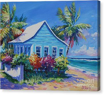 Blue Cottage On The Beach Canvas Print by John Clark