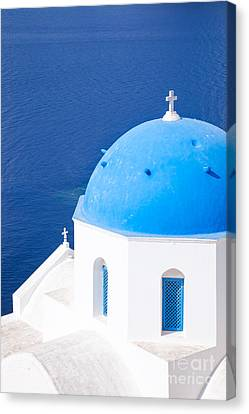 Blue Domed Church In Oia - Santorini - Greece Canvas Print by Matteo Colombo