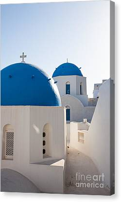 Blue Domed Churches Of Oia - Santorini - Greece Canvas Print by Matteo Colombo