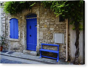 Blue Door And Bench Arles France Dsc01810  Canvas Print by Greg Kluempers