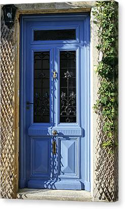 Blue Door With Dappled Sunlight Canvas Print by Georgia Fowler