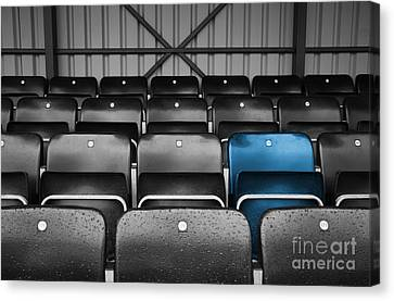 Blue Seat In The Football Stand Canvas Print by Natalie Kinnear