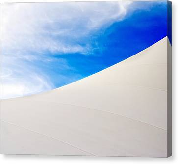 Blue Sky White Canvas Canvas Print by Kevin Anderson