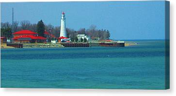 Blue Water Lighthouse Canvas Print by Peg Holmes