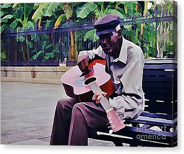 Blues Guitar Player In New Orleans Canvas Print by John Malone