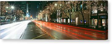 Blurred Motion Of Cars Along Michigan Canvas Print by Panoramic Images