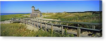 Boardwalk Leading Towards Old Harbor Canvas Print by Panoramic Images