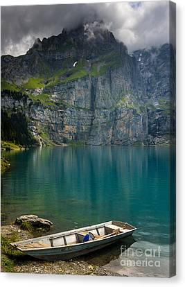 Boat On The Oeschinensee - Swiss Alps  Canvas Print by Gary Whitton