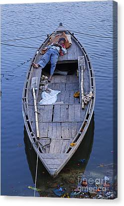 Boat On The River Ganges At Varanasi Canvas Print by Robert Preston