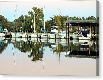 Boats And Reflections Canvas Print by Carolyn Ricks