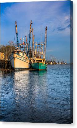Boats In Blue Canvas Print by Debra and Dave Vanderlaan