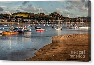Boats In The Harbour Canvas Print by Adrian Evans