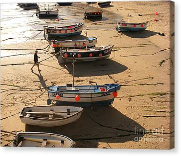 Boats On Beach Canvas Print by Pixel  Chimp