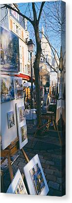 Books At A Stall With Basilique Du Canvas Print by Panoramic Images