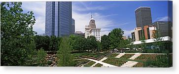 Botanical Garden With Skyscrapers Canvas Print by Panoramic Images