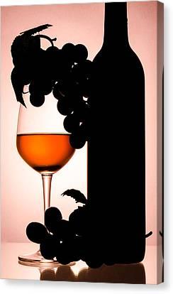 Bottle And Wine Glass Canvas Print by Sirapol Siricharattakul