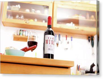 Bottle Of Red Wine On A Kitchen Table Canvas Print by Wladimir Bulgar