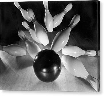 Bowling Ball Strikes Pins Canvas Print by Underwood Archives