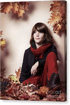 Boy Sitting On Autumn Leaves Artistic Portrait Canvas Print by Oleksiy Maksymenko