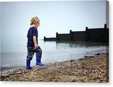 Boy Walking On Beach Canvas Print by Ruth Jenkinson