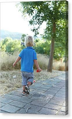 Boy Walking On Path Canvas Print by Ruth Jenkinson