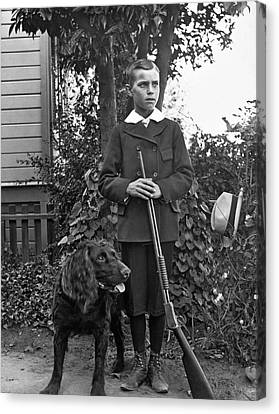 Boy With His Rifle And Dog Canvas Print by Underwood Archives