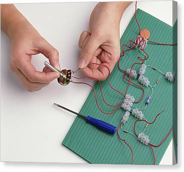 Boy's Hands Attaching Wires Canvas Print by Dorling Kindersley/uig